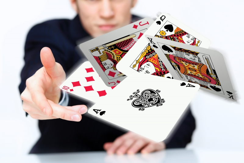 2777361-young-man-showing-poker-cards